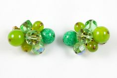 "Vintage Hattie Carnegie green aurora borealis cluster earrings. The deep and rich colors are fantastic and the beads are in very good condition. There is minor wear to the finish on the backside of the earrings but otherwise in very good condition. They measure approximately 1"" x 1.25""."