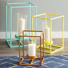 3 Piece Iron Candle Lantern Set is part of Home Accessories Candles Living Rooms Featuring open iron frames and simple glass hurricanes, this understated lantern set lends a chic touch to your decor - Home Accessories, Candle Lanterns, Contemporary Candle Holders, Candles, Gold Home Accessories, Metal Candle Lanterns, Iron Candle, Pallet Home Decor, Living Room Candles