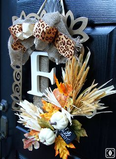 Add drama to your front door by decorating a wooden frame with charming autumn flowers accented with animal print ribbon.