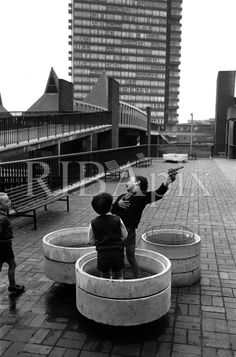 VC. (Pepys Estate, Deptford, London: children playing on a raised walkway, photographed by Tony Ray-Jones, 1966) [RIBA15751]