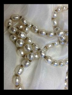 Outlander costumer:Baroque pearls with gold roundels. I didn't want such a long strand. But you win some, you lose some.