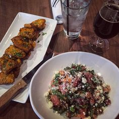First meal in Austin: osso bucco riblets  watermelon-quinoa-arugula-kale salad and a coconut porter  @eurekaaustin #foodporn #austin #foodie #food #foodgasm #texas #yummy #foodie #goodeats #delicious #happyhour #foodstagram #instafood #foodlover by cinlincinlin