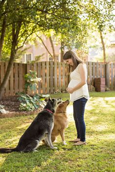 Maternity picture with dogs. Pregnant mama poses with her two puppies. #maternity #maternityideas