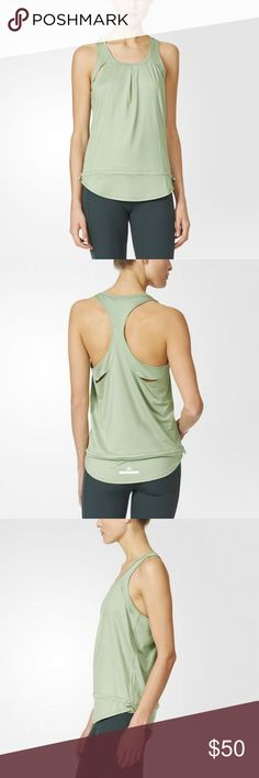 NWT adidas by Stella McCartney The Starter Tank Since 2005 Performance Tank Top Spring Green-Smc Women adidas by Stella McCartney Clothing A signature piece brought back from adidas by Stella McCartney's very first season, the Since 2005 Performance Tank Top has an oversize shape, peek-a-boo cutouts and a drawcord to customise the fit. Loose fit climalite® fabric sweeps sweat away from your skin Rounded neck Racer back; Front and back cutouts Drawcord on waist 88% polyester / 12% elastane…