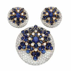 White Gold, Gold, Diamond and Sapphire Clip-Brooch and Pair of Earclips, France  18 kt., the circular bombe mountings encrusted with 362 round diamonds, centering three stylized flowers embellished by oval sapphires set in yellow gold, accented by 22 round diamonds, the diamonds totaling approximately 30.50 cts., with French assay marks, engraved SO for special order,