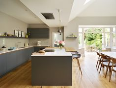 This kitchen boasts a large amount of worktop space for that busy chef as well as an extended timber breakfast bar Family Kitchen, Home Decor Kitchen, Kitchen Living, Kitchen Ideas, Kitchen Island With Sink, Open Kitchen, Kitchen Islands, Bespoke Kitchens, Grey Kitchens