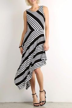 be5eb966ab Stripe sleeveless midi dress in a relaxed style with a crew neck and  asymmetric hem.