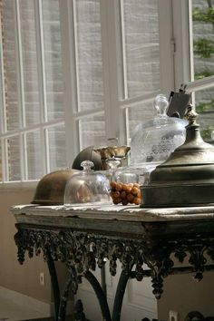 Beautiful old pastry table topped with cloche antique vignette.