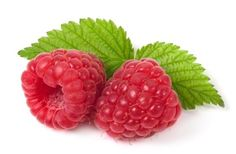 Rasberry with leaf on white background