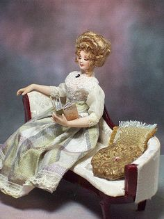 Paulette reads a book of poetry. Lounge doll book all included.