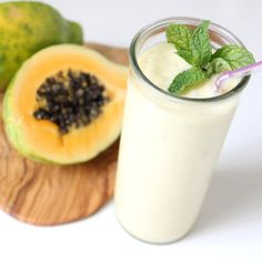 Remedy Digestion Woes With This Papaya Ginger Mint Smoothie 1 papaya (Solo or Mexican), peeled, seeded, and cut into chunks 1/2 cup ice cubes 1/2 cup nonfat Greek yogurt 1/2 tablespoon finely chopped peeled fresh ginger 1/2 tablespoon honey Juice of 1/2 lemon Water, to taste 4 fresh mint leaves, plus 1-2 sprigs for garnish