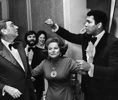 """At a dinner honoring the six """"Outstanding Chicagoans of Today,"""" boxing champ Muhammad Ali takes a playful poke at sportscaster Howard Cosell, as Ann Landers advises them to break it up Nov. in Chicago. Muhammad Ali Birthday, Star Trek Posters, Float Like A Butterfly, Hometown Heroes, Boxing Champions, Odd Couples, Dc Comics Characters, Sports Figures, American Comics"""