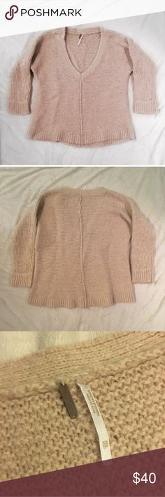 Free people chunky oversized sweater free people sweater!! Is pretty slouchy and oversized. It's chunky & a pink/cream color. The sleeves are 3/4 length. Has a lower v neck with a line down the center of both the front and the back. It's in excellent used condition. The only sign of wear is that there are little fuzzies (kind of like piling). You know what I mean lol :) if you have a sweater shaver, the fuzz will definitely come right off!   Material: 40% acrylic, 30% nylon, 26% wool, 10%…
