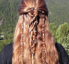 A classic fishtail braid wrapped in four english braids - all covered with hair beads!