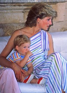 August 9, 1986: Princess Diana with Prince Harry on holiday at the Marivent…