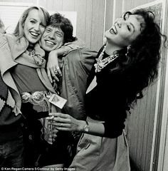 Jagger backstage with Jerry Hall and Marie Helvin...