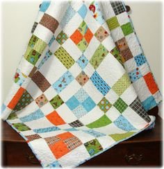 Wedding quilt instead of guest book.  We could use different fabrics.  The white squares/rectangles for quests to write on.