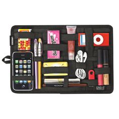"Cocoon Innovations GridIt Organizer Medium    A unique weave of rubberized elastic bands made specifically to hold personal objects firmly in place. Designed to provide endless configurations of objects, digital devices and personal effects. 8""x 12""          Brand: Cocoon Innovations"