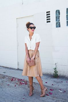 A leather skirt adds edge to a ladylike ensemble.