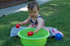 "{Water Scooping for Babies} ""While my older daughter tore up the grass with the Slip 'n Slide, I set my 10 month old up with a bucket of water and some measuring cups. And she got right to work, filling and emptying the cups."" Keep your little ones entertained too! #WaterFun #CampSunnyPatch"