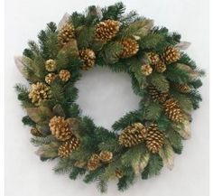Subtle Shimmer  26 INCHES - The shimmering mix of gilded pinecones, sheer magnolia leaves and evergreens are dusted in a sparkling gold glitter that creates a subtle but finished look.  $49.99