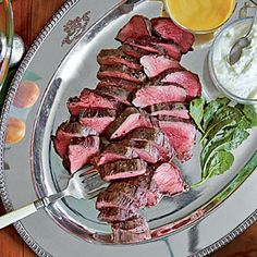 Perfect Beef Tenderloin (see attached links for Homemade Hot Mustard and Horseradish Sauce) - sliced and served with Sister Schubert rolls!