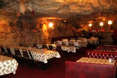 The Cave, Richland Missouri..... is the nation's only restaurant located in a cave, serving American steakhouse/seafood and Italian fare. The space does not get natural light, but has waterfalls, fish ponds, and  a view of the Gasconade River.