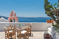 """Entire home/apt in Oia, Greece. This house is the """"it"""" property of Santorini, positioned in the quintessential location of Oia's postcard views-at Oia's famous blue dome! A fully . Cheap Hotels In Santorini, Santorini House, Santorini Greece, Greece Vacation, Greece Travel, Greece Honeymoon, Best Hotels In Greece, Jacuzzi Outdoor, Famous Castles"""