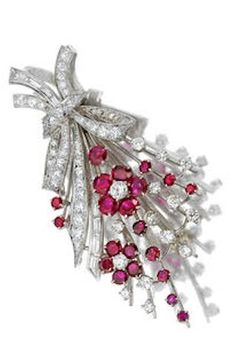 *A diamond and ruby brooch, Cartier designed as a vari-cut diamond and ruby foliate spray; signed Cartier, no. 45284, with signed box; estimated total diamond weight: 2.45 carats; mounted in platinum.