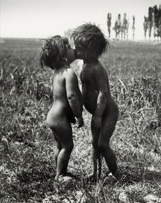 Gypsy Children Kissing, Esztergom, Hungary by André Kertész, 1917
