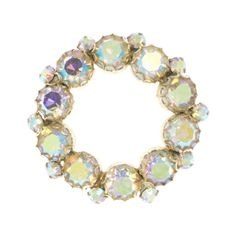 Aurora borealis wreath shaped vintage brooch, signed by Weiss, £35 from Otterley & Hester.  http://otterleyandhester.co.uk/collections/brooches/products/weiss-aurora-borealis-vintage-brooch