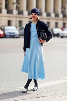 Calf length A-line dress, cabled beanie, bomber jacket, flats. Paris Fashion Week, Street style.