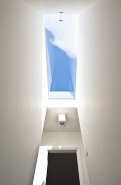The major refurbishment of a stucco-fronted terraced house in central London. The work focused on the qualities imparted by materials on the spaces they inhabit Loft Conversion Extension, Loft Conversions, Roof Light, Through The Looking Glass, Skylight, Ground Floor, Nice View, Terrace, Minimalism