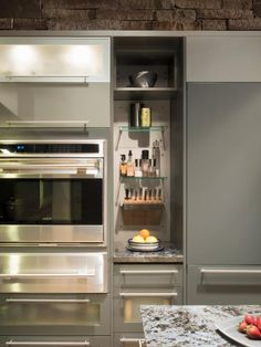 Kitchen: Open Shelving In Silky Gray Kitchen. small kitchen appliances. gray kitchen cabinet. stainless steel microwave oven. straight bar pulls. knife board. glass shelving.