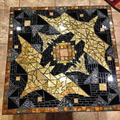 This Mandala Style Batman Table is 2X2 and about 23 inches high. Black table with Gold crackle top edge. Gold Van Gogh and Mirror Glass make up