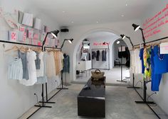 love the writing on the wall and the racks but there's so much unused space directly above racks perhaps for purses....Also I would like to put framed runway pictures around clothes that relate to them, inspiration wise.