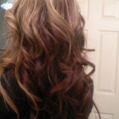 Caramel highlights with burgundy color underneath. My new summer look.