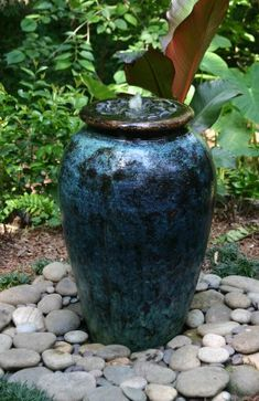 Any plastic or ceramic container can be used for a water feature. It can be filled with water or rocks, depending on what is needed.