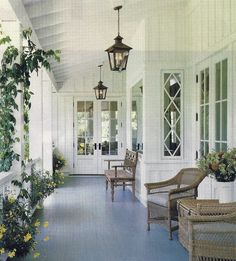 Love this front porch and especially the diamond paned windows, black lanterns, and painted floor.  #countryliving #dreamporch
