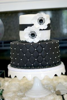 Black and white Chanel themed cake for a baby shower on www.ahappyblog.com