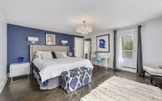 Master bedroom with blue accent wall | Classic 1930's Center Hall Colonial with contemporary style | 50 Shingle House Road, Chappaqua, NY | Karin Kimtis of Houlihan Lawrence Chappaqua