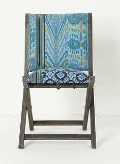 stunning ikat cushions on simple rustic chair