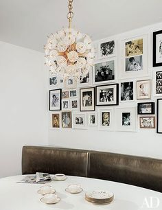 Black-and-white photos cover a wall of the breakfast area in a David Mann–designed New York duplex | archdigest.com