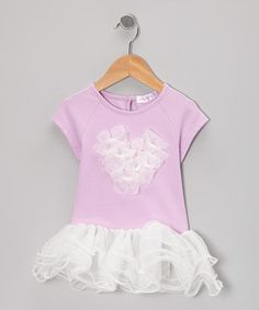 Delightful layers of ruffled tulle work to keep this top looking fancifully fun, while the spandex blend tops it off in splendid comfort.  Size note: This item runs small. Please refer to the size chart when ordering.