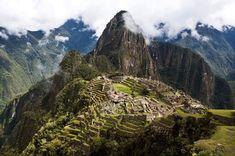 natgeotravel     Photo by @jessmandia | Scattered clouds form above a sprawling panoramic view of Peru's famed Machu Picchu. In partnership with @inkaterrahotels #40yearsofinkaterra #machupicchu #peru