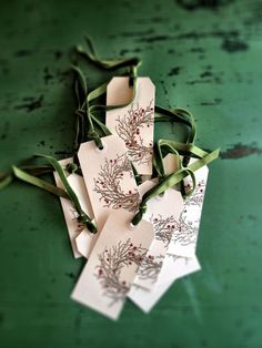"""Here's a quick tutorial for some lovely but easy Christmas gift tags...The supplies and tools you'll need: A heat tool like this (not in photo), some white shipping tags (mine are about 4""""), a paintbrush, a wreath rubber stamp like this one or this one, some red fluid acrylic paint, an…"""