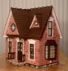 Little details, such as the golden doorknob, or the raised details on the exterior trims, makes this dollhouse a truly one-of-a-kind creation. Description from dollhouseminis.blogspot.com. I searched for this on bing.com/images