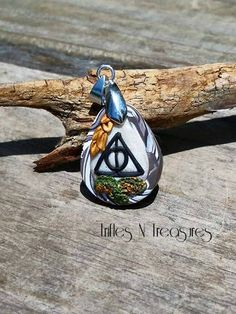 Deathly Hallows Inspired Polymer Clay Pendant by TNTPatterns