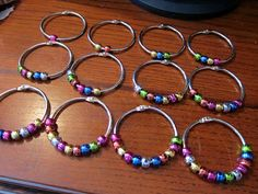 "For these rings, I purchased 2"" book rings (set of 12) from Office Max for $4.79 and some beads from Michael's for $2.49 (only used a few, so these can be used for another project as well)."