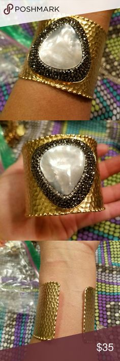Rare Beatiful cuff NWOT This is such a precious piece.A very elegant stament cuff with mother of pearl and black crystal stones.Really amazing ,back is open to accommodate to your size Jewelry Bracelets